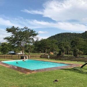 Guests enjoying pool at mankele - Things to do in Nelspruit- Shandon Lodge